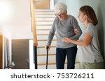 homecare helping elderly woman... | Shutterstock . vector #753726211