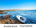 Small photo of Sailboat aground on the rocks