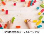top view on child's hands... | Shutterstock . vector #753740449