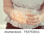 woman eat medicine. feeling... | Shutterstock . vector #753752011