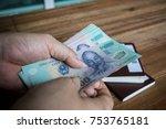 vietnam dong bank note in woman ... | Shutterstock . vector #753765181
