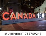 Small photo of Toronto, Canada - Oct 12, 2017: Canada 150 years anniversary celebration sign illuminated at night. City of Toronto, Canada