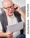 Small photo of Senior citizen calling on the phone with his smartphone