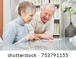senior couple calculating with... | Shutterstock . vector #753791155