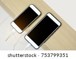 two white mobile phone on table ... | Shutterstock . vector #753799351