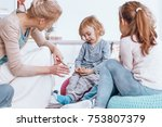 teacher talking to a shy boy... | Shutterstock . vector #753807379