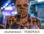 caucasian young male eating...   Shutterstock . vector #753829315