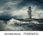lighthouse on the sea under sky. | Shutterstock . vector #753856921
