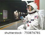 an astronaut dressed man uses... | Shutterstock . vector #753876781