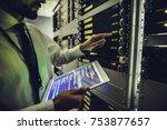 handsome man is working in data ... | Shutterstock . vector #753877657
