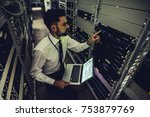 handsome man is working in data ...   Shutterstock . vector #753879769