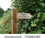 wooden sign indicating public...