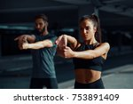 young sports couple exercising... | Shutterstock . vector #753891409