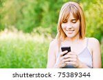Lovely Smiling Girl Reads Sms...