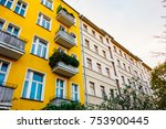 yellow and white houses in a row | Shutterstock . vector #753900445