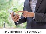businessman touch on smartphone ... | Shutterstock . vector #753900829