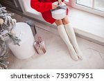 happy girl holding a gift box... | Shutterstock . vector #753907951