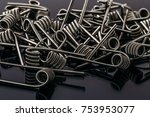 Small photo of Group of Fussed Clapton Coils for vape or e-cig dripping atomizers or RDA, accessories for vaping, macro photo