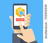 parcel tracking. hand holding... | Shutterstock .eps vector #753955549