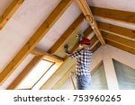 man installing thermal roof... | Shutterstock . vector #753960265