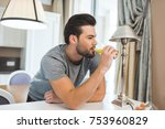 handsome young man drinking... | Shutterstock . vector #753960829