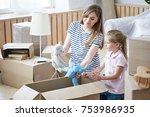 pretty young mother and her... | Shutterstock . vector #753986935