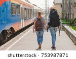happy young couple on railway... | Shutterstock . vector #753987871