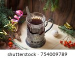 black tea in an old cup holder | Shutterstock . vector #754009789