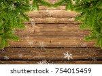 wood background with fir branch ... | Shutterstock . vector #754015459