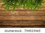 wood background with fir branch ... | Shutterstock . vector #754015465