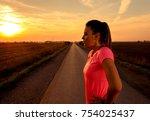 athletic woman preparing run on ... | Shutterstock . vector #754025437