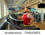 a fat man is walking running...   Shutterstock . vector #754025851