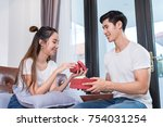 young asian couple valentine... | Shutterstock . vector #754031254