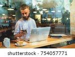 popular blogger checking the... | Shutterstock . vector #754057771