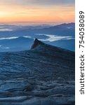 the south peak at kinabalu... | Shutterstock . vector #754058089