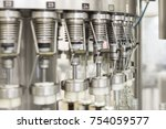 automatic filling machine...   Shutterstock . vector #754059577