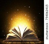 open book on wooden vintage... | Shutterstock . vector #754062415