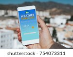 weather forecast mobile phone... | Shutterstock . vector #754073311