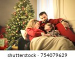 sweet family sitting on the... | Shutterstock . vector #754079629