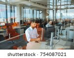 shot of a man working in an... | Shutterstock . vector #754087021