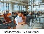 shot of a man working in an... | Shutterstock . vector #754087021