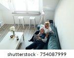 elderly couple lying on the... | Shutterstock . vector #754087999