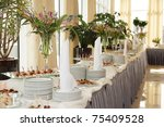 table with dishware and tasty... | Shutterstock . vector #75409528
