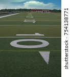Small photo of 10 yard line hash mark on the football field.