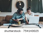 happy couple sitting and...   Shutterstock . vector #754143025
