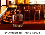 tumbler glass with whiskey at... | Shutterstock . vector #754143475