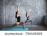 pair sporty yoga women doing... | Shutterstock . vector #754145305