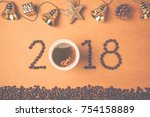 2018 coffee beans and a cup of... | Shutterstock . vector #754158889