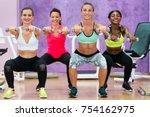 beautiful athletic women doing... | Shutterstock . vector #754162975