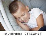 portrait of cute little boy in... | Shutterstock . vector #754210417